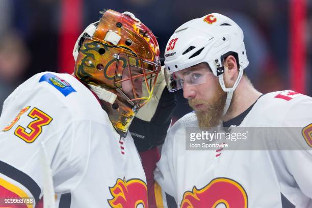 Calgary Flames Goalie David Rittich is congratulated on his victory by Calgary Flames Left Wing Sam Bennett after third period National Hockey League...