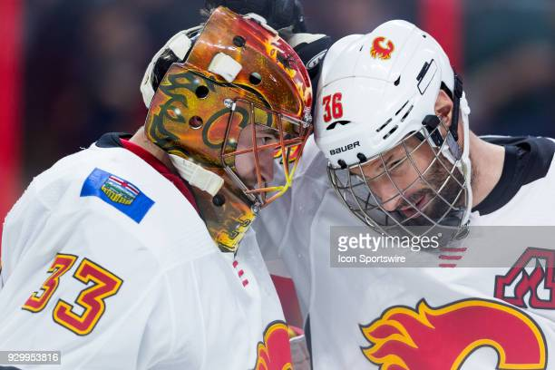 Calgary Flames Goalie David Rittich is congratulated on his victory by Calgary Flames Right Wing Troy Brouwer after third period National Hockey...