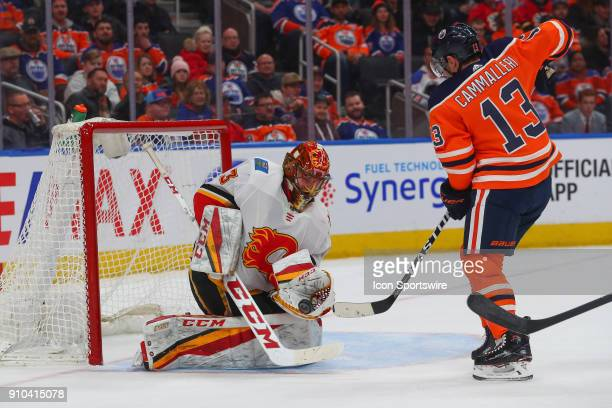 Calgary Flames Goalie David Rittich makes a save on Edmonton Oilers Right Wing Michael Cammalleri during the Edmonton Oilers versus the Calgary...
