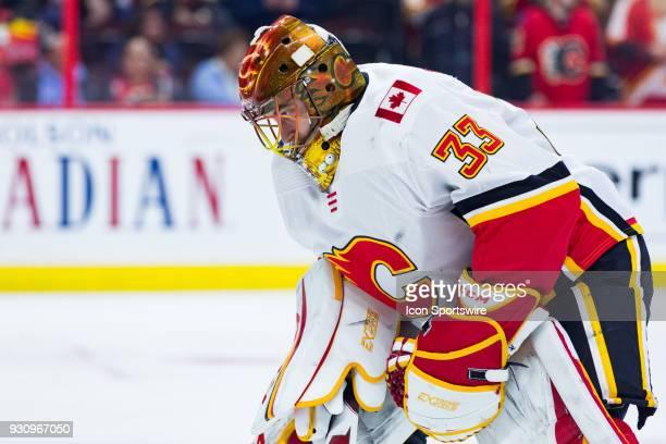 Calgary Flames Goalie David Rittich takes a moment during warmup before National Hockey League action between the Calgary Flames and Ottawa Senators...