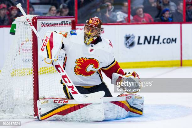 Calgary Flames Goalie David Rittich tracks the puck after making a blocker save during third period National Hockey League action between the Calgary...