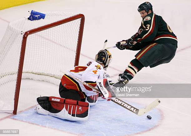 Calgary Flames goalie Miikka Kiprusoff stops the shot from Matt Foy of the Minnesota Wild, the shot was put into the net immediately after during...