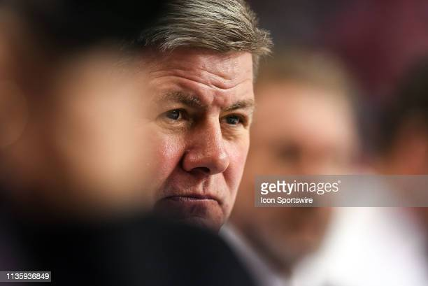 Calgary Flames head coach Bill Peters watches warm ups before an NHL game where the Calgary Flames hosted the Edmonton Oilers on April 6 at the...