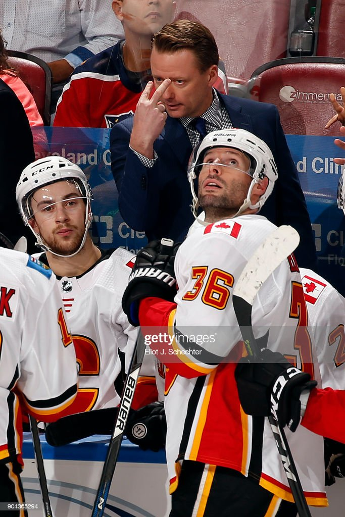 Calgary Flames Head Coach Glen Gulutzan directs his team from the bench against the Florida Panthers at the BB&T Center on January 12, 2018 in Sunrise, Florida.