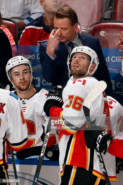 Calgary Flames Head Coach Glen Gulutzan directs his team from the bench against the Florida Panthers at the BBT Center on January 12 2018 in Sunrise...