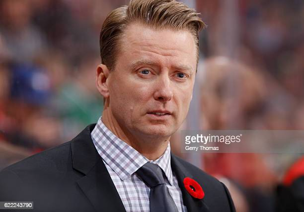 Calgary Flames head coach Glen Gulutzan mans the bench against the Dallas Stars at Scotiabank Saddledome on November 10 2016 in Calgary Alberta Canada