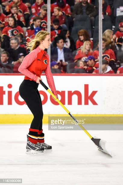 Calgary Flames ice girl cleans the ice during the first period of an NHL game where the Calgary Flames hosted the Dallas Stars on November 13 at the...