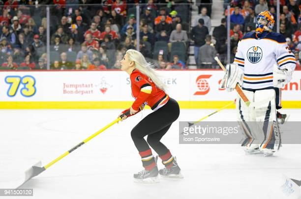 Calgary Flames ice girl skates past Edmonton Oilers Goalie Al Montoya during the first period on Saturday March 31 2018 at the Scotiabank Saddledome...