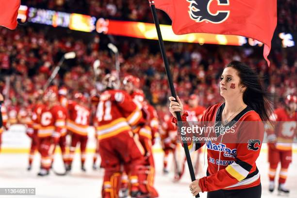Calgary Flames ice girls celebrate their team's 40 win over the Colorado Avalanche after Game One of the Western Conference First Round during the...