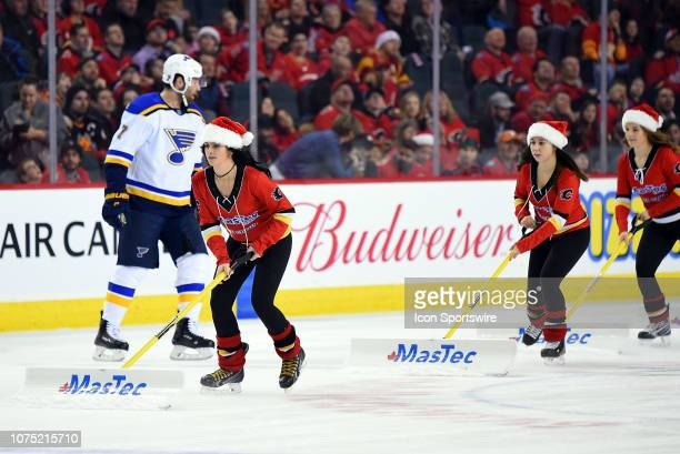 Calgary Flames ice girls come out between whistles during an NHL game where the Calgary Flames hosted the St Louis Blues on December 22 at the...