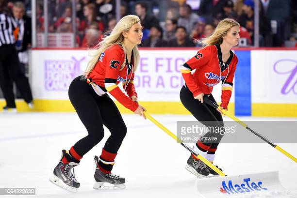 Calgary Flames ice girls shovels the snow during the second period of an NHL game where the Calgary Flames hosted the Vegas Golden Knights on...