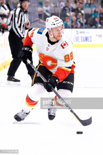 Calgary Flames left wing Andrew Mangiapane carries the puck during the San Jose Sharks game versus the Calgary Flames on September 26 at SAP Center...
