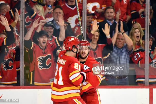 Calgary Flames Left Wing Andrew Mangiapane celebrates a goal with Right Wing Garnet Hathaway during the second period of Game One of the Western...