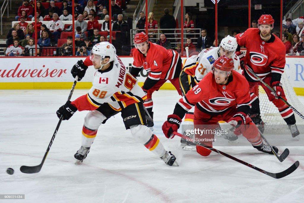 Calgary Flames Left Wing Andrew Mangiapane (88) clears the puck during a game between the Calgary Flames and the Carolina Hurricanes at the PNC Arena in Raleigh, NC on January 14, 2018. Calgary defeated Carolina 4-1.