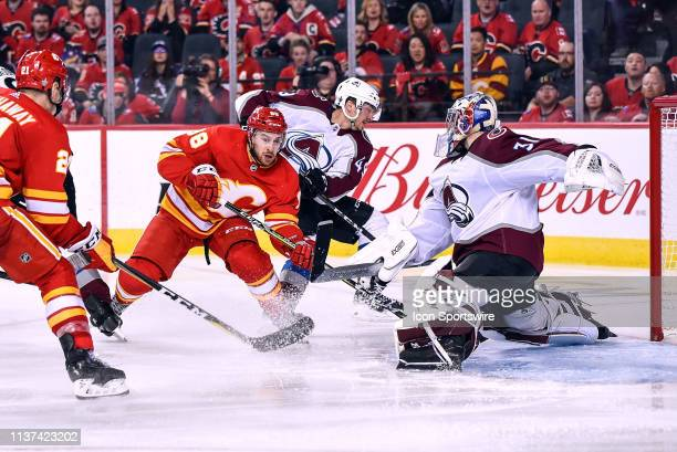 Calgary Flames Left Wing Andrew Mangiapane is unable to score as Colorado Avalanche Goalie Philipp Grubauer stretches to cover his net during the...