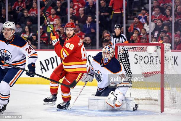 Calgary Flames Left Wing Andrew Mangiapane stands in front of Edmonton Oilers Goalie Mikko Koskinen during the first period of an NHL game where the...