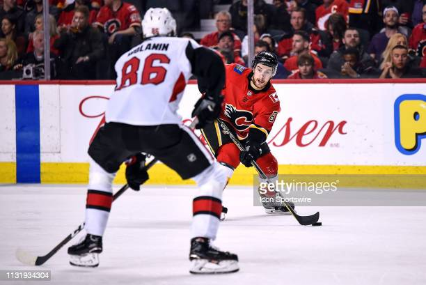 Calgary Flames Left Wing Andrew Mangiapane stickhandles into the Ottawa Senators zone during the third period of an NHL game where the Calgary Flames...