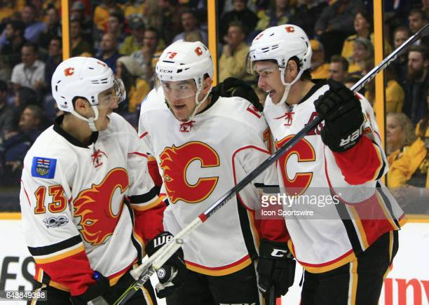 Calgary Flames left wing Johnny Gaudreau and center Sean Monahan celebrate a goal by left wing Micheal Ferland during the NHL game between the...