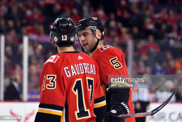 Calgary Flames Left Wing Johnny Gaudreau and Defenceman Mark Giordano discuss strategy between whistles during the first period of an NHL game where...