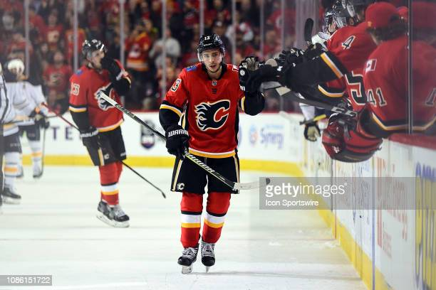 Calgary Flames Left Wing Johnny Gaudreau and teammates celebrate a goal during the first period of an NHL game where the Calgary Flames hosted the...