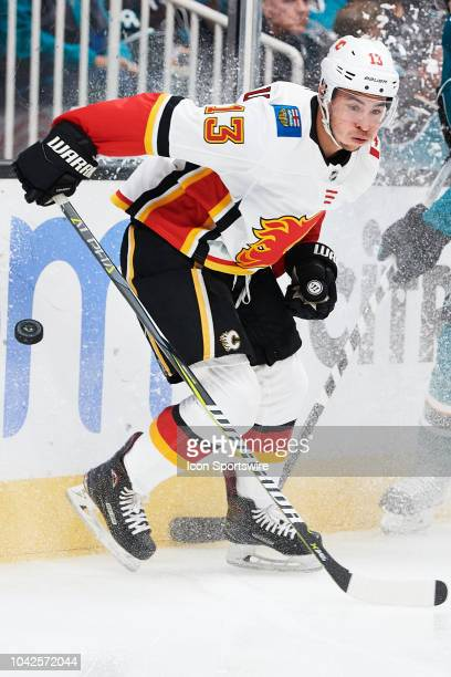 Calgary Flames left wing Johnny Gaudreau battles for the puck during the San Jose Sharks game versus the Calgary Flames on September 27 at SAP Center...
