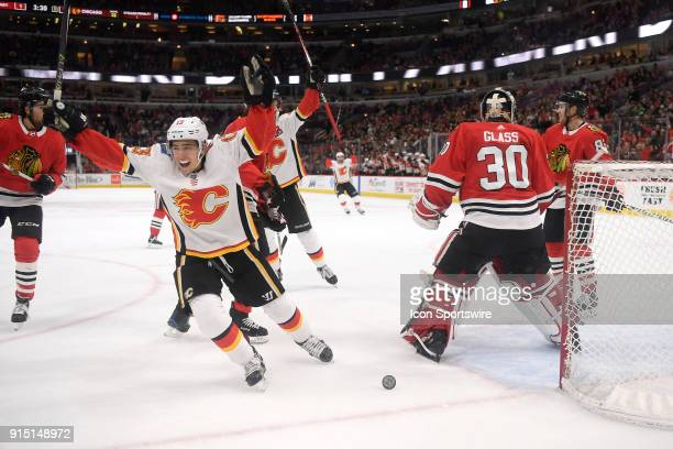 Calgary Flames left wing Johnny Gaudreau celebrates a goal scored by Calgary Flames defenseman Michael Stone during a game between the Chicago...