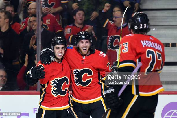 Calgary Flames Left Wing Johnny Gaudreau celebrates his goal with Center Elias Lindholm and Center Sean Monahan during the first period of an NHL...