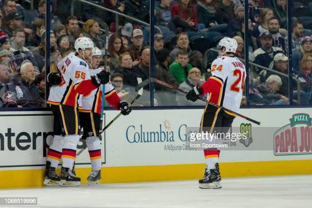 Calgary Flames left wing Johnny Gaudreau celebrates with teammates after scoring a goal in a game between the Columbus Blue Jackets and the Calgary...