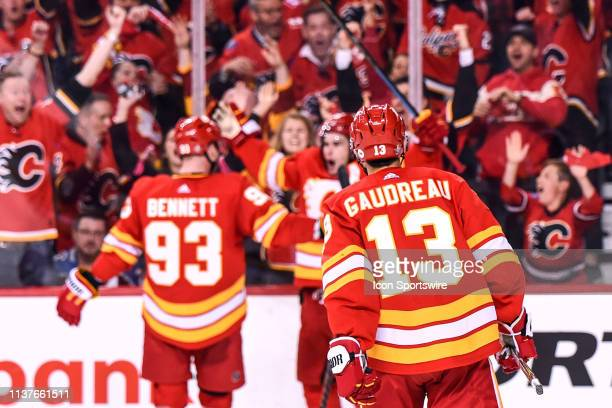 Calgary Flames Left Wing Johnny Gaudreau goes to celebrate a goal with Center Sean Monahan and Winger Sam Bennett during the third period of Game Two...