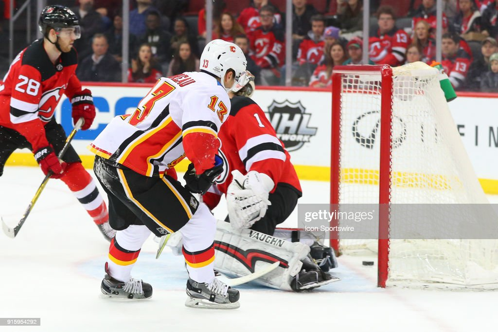 Calgary Flames left wing Johnny Gaudreau (13) scores during the second period of the National Hockey League game between the New Jersey Devils and the Calgary Flames on February 8, 2018, at the Prudential Center in Newark, NJ.