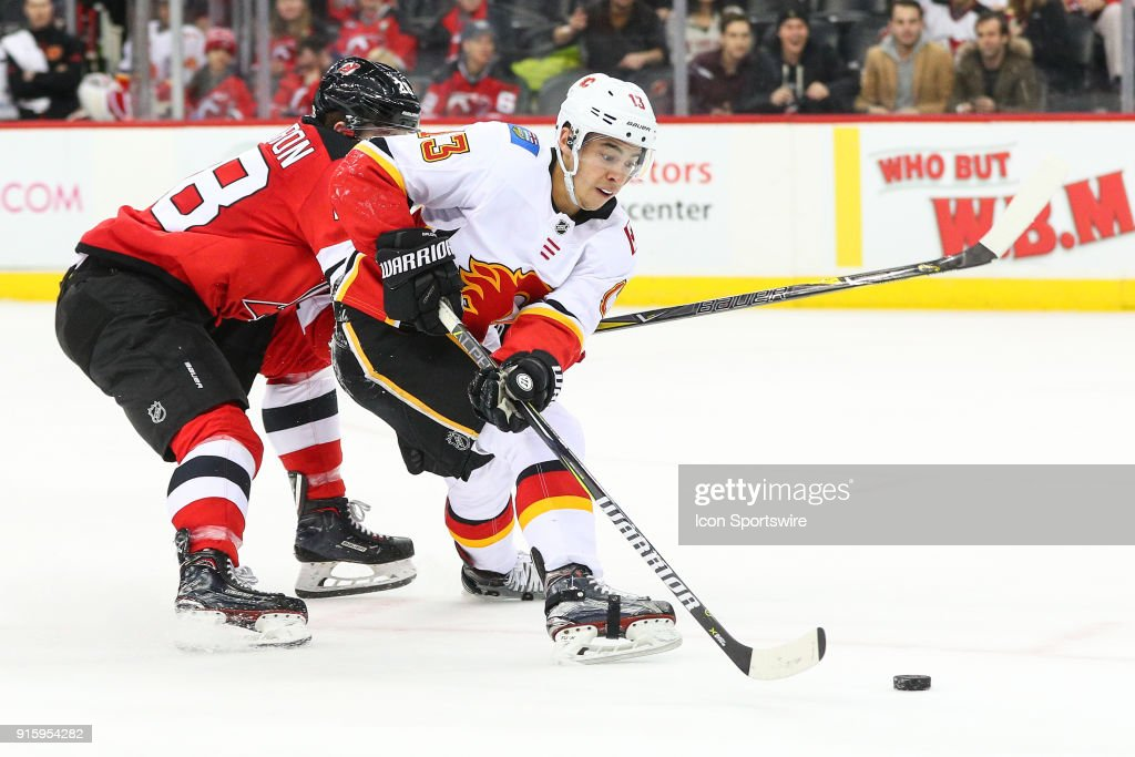 Calgary Flames left wing Johnny Gaudreau (13) skates and scores on a backhand shot during the second period of the National Hockey League game between the New Jersey Devils and the Calgary Flames on February 8, 2018, at the Prudential Center in Newark, NJ.