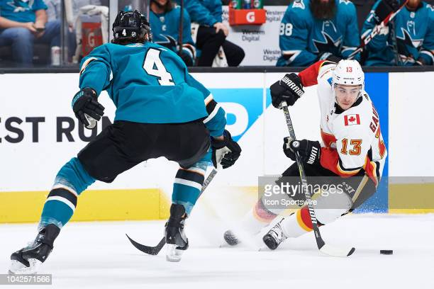 Calgary Flames left wing Johnny Gaudreau skates away from San Jose Sharks defenseman Brenden Dillon during the San Jose Sharks game versus the...