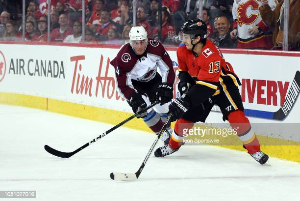 Calgary Flames Left Wing Johnny Gaudreau skates with the puck as Colorado Avalanche Defenceman Tyson Barrie pursues him during the third period of an...
