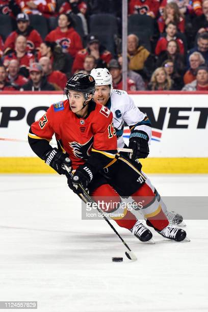 Calgary Flames Left Wing Johnny Gaudreau skates with the puck while San Jose Sharks Right Wing Joe Pavelski pursues him during the second period of...
