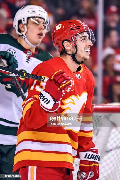 Calgary Flames Left Wing Johnny Gaudreau smiles as he watches the replay during the second period of an NHL game where the Calgary Flames hosted the...