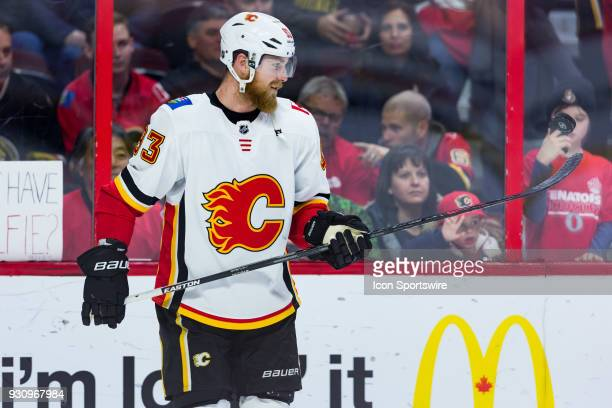 Calgary Flames Left Wing Sam Bennett plays with a puck during warmup before National Hockey League action between the Calgary Flames and Ottawa...