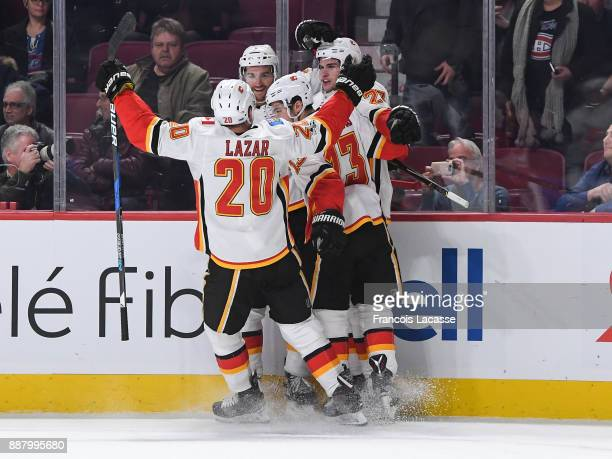 Calgary Flames players celebrate after defeating the Montreal Canadiens in the NHL game at the Bell Centre on December 7 2017 in Montreal Quebec...
