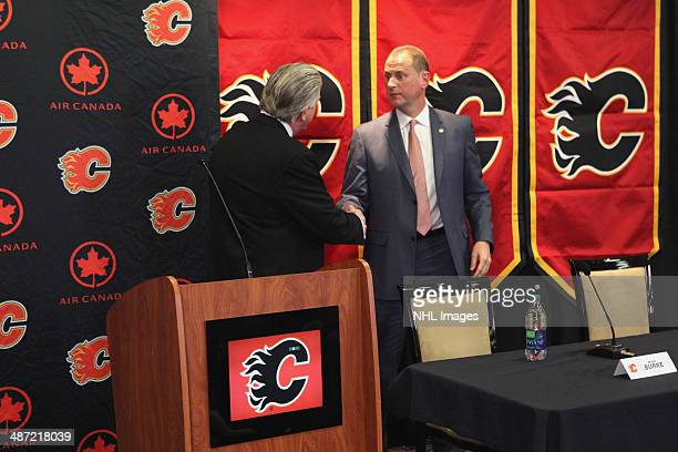Calgary Flames President of Hockey Operations Brian Burke shakes hands with new General Manager Brad Treliving at Scotiabank Saddledome on April 28...