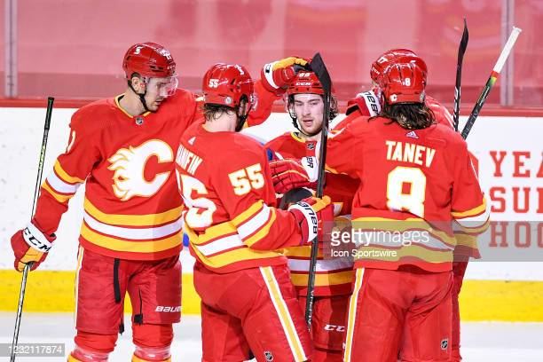 Calgary Flames Right Wing Andrew Mangiapane celebrates a goal against the Toronto Maple Leafs with Calgary Flames Center Mikael Backlund , Calgary...