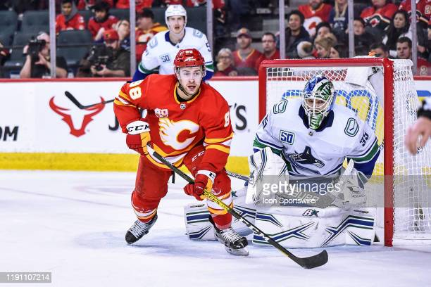 Calgary Flames Right Wing Andrew Mangiapane skates past Vancouver Canucks Goalie Thatcher Demko during the third period of an NHL game where the...