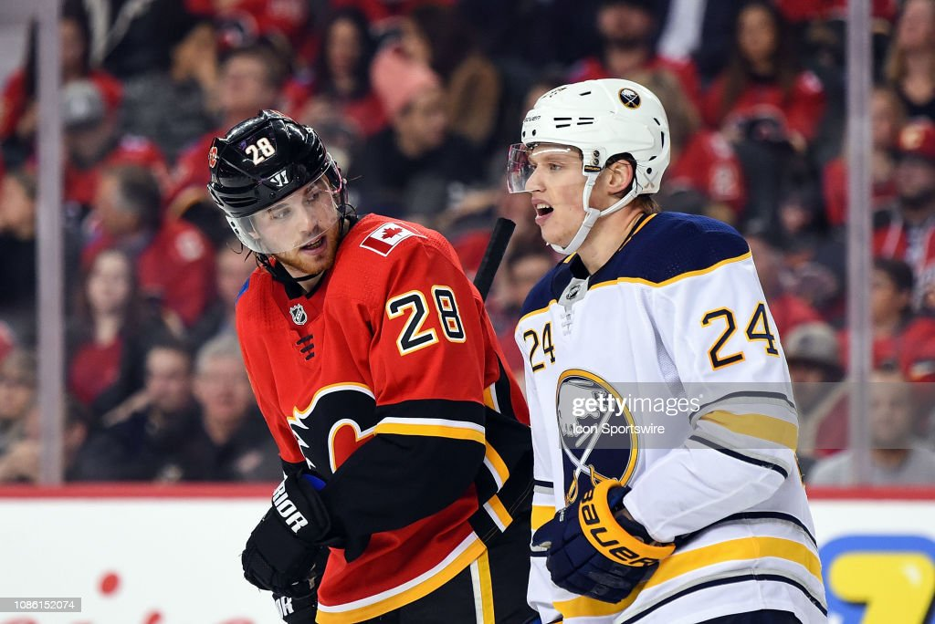 Calgary Flames Right Wing Elias Lindholm looks at Buffalo Sabres