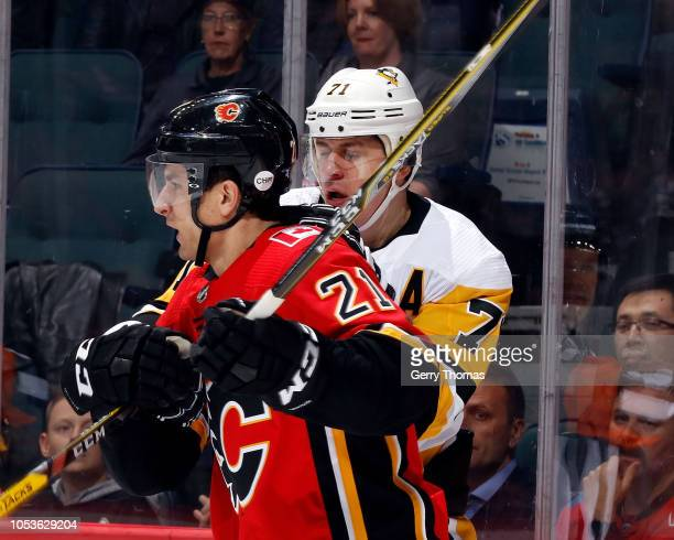 Calgary Flames Right Wing Garnet Hathaway and Pittsburgh Penguins Center Evgeni Malkin compete for position during an NHL game on October 25 2018 at...