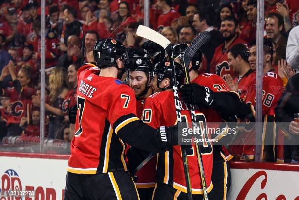Calgary Flames Right Wing Garnet Hathaway Center Derek Ryan Left Wing Andrew Mangiapane and Defenceman TJ Brodie celebrate a goal during the first...