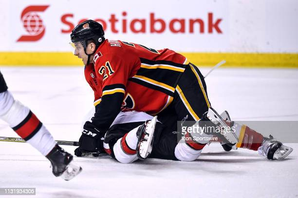 Calgary Flames Right Wing Garnet Hathaway falls on Ottawa Senators Defenceman Erik Brannstrom during the third period of an NHL game where the...