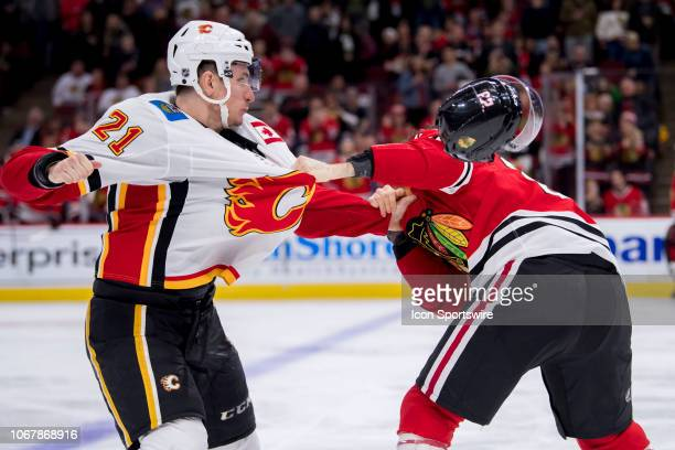 Calgary Flames right wing Garnet Hathaway fights Chicago Blackhawks defenseman Brandon Manning during a game between the Calgary Flames and the...