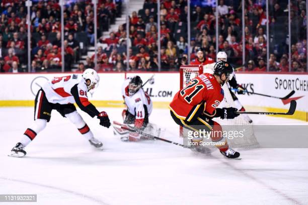 Calgary Flames Right Wing Garnet Hathaway scores a goal on Ottawa Senators Goalie Craig Anderson during the first period of an NHL game where the...