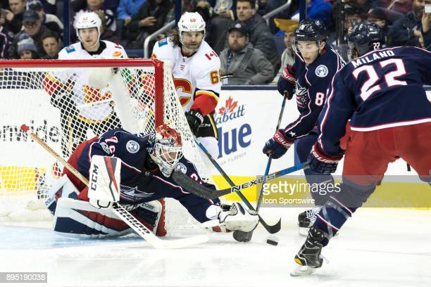 Calgary Flames right wing Jaromir Jagr takes a shot on goal while Columbus Blue Jackets goalie Sergei Bobrovsky reaches out to fall on the puck in...