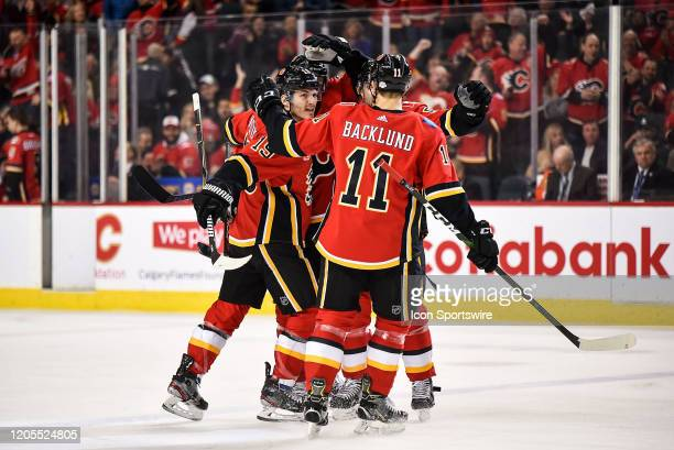 Calgary Flames Right Wing Matthew Tkachuk Calgary Flames Center Mikael Backlund and teammates celebrate a goal by Calgary Flames Defenceman TJ Brodie...