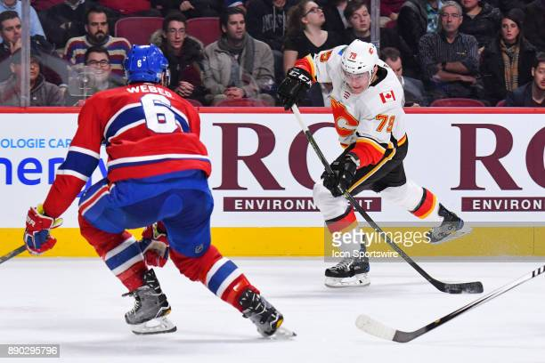 Calgary Flames Right Wing Micheal Ferland shoots the puck in front of Montreal Canadiens Defenceman Shea Weber during the Calgary Flames versus the...