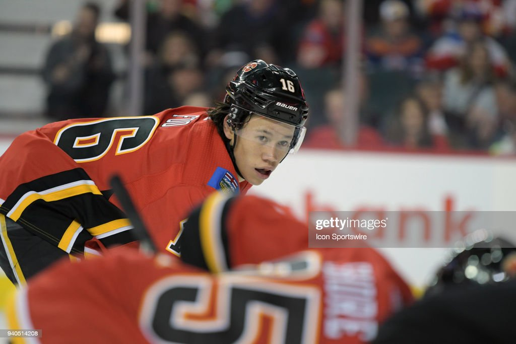 Calgary Flames Right Wing Spencer Foo (16) watches the face-off during his NHL debut with the Calgary Flames as they took on the Edmonton Oilers Saturday, March 31, 2018 at the Scotiabank Saddledome in Calgary, AB. The Flames won the game 3-2.